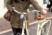 Woman with retro bycicle — Stock Photo