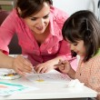 Mother and daughter painting together — Stock Photo
