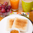 Breakfast with toast, orange juice and grapes — Stock Photo