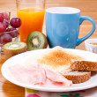 Full breakfast with fruit — Stock Photo