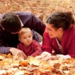 Happy family at the park in autumn — Stock Photo