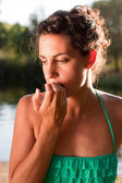 Worried woman biting nails — Stock Photo