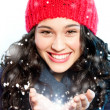 Christmas girl with snow in hands — Stock Photo