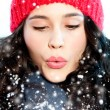 Christmas girl blowing snow in hands — Foto de Stock