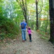 Father and daughter walking in the forest — ストック写真