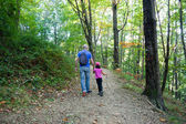 Father and daughter walking in the forest — Stock Photo