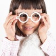 Girl trying toy glasses — Stock Photo #35358391