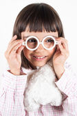 Girl trying toy glasses — Stock Photo