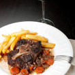 Stock Photo: Oxtail stew with carrots and fries