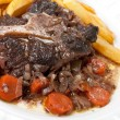 Oxtail stew with carrots and fries — Stock Photo