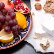 Brie cheese with bread and fruits — Stock Photo