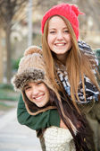 Beautiful winter girls with woolen caps — Stock Photo
