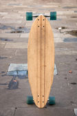 Skate board standing on the ground — Stok fotoğraf
