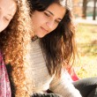 Teen girls studying outdoors — Stock Photo