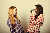 Funny hipster girls portraying with an old film camera — Stock Photo