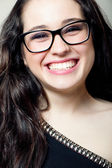 Attractive girl with glasses laughing — Stock Photo