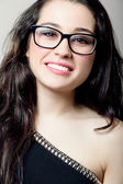 Beautiful girl with glasses smiling — Stock Photo