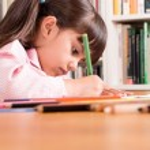Little girl doing homework — Stock Photo #48887461