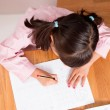 Girl learning to write — Stock Photo #48887515