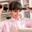 Funny school girl with pigtails — Stock Photo #49451517