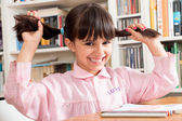 Funny school girl with pigtails — Stock Photo