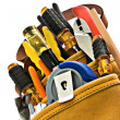 Royalty-Free Stock Photo: Carpenter or Electrician Tool Bag Stuffed with New Tools - Isolated on White