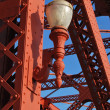 Deco Light on Victorian Red Iron Bridge - Stock Photo