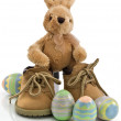 EasterBunny with Big Boots and Colored Eggs Isolated - Stockfoto