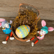 Easter Eggs. Bunnies, Real Nest on Vintage Wood Table - High Resolution Image Available - Stock Photo