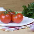 Three red tomatoes — Stockfoto