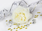 Decorative composition with a white rose — Stock Photo