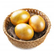 Three golden eggs — Stock Photo