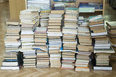 Tall stacks of old books — Stock Photo