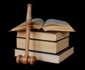 Gavel and stack of thick old books — Stock Photo