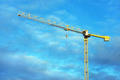 Building crane on a background of sky — Stock Photo