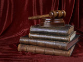 Wood gavel and stack of old books — Stock Photo