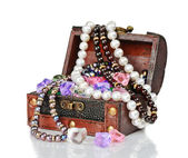 Gems in the open wooden chest — Stock Photo