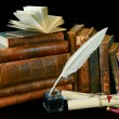 Vintage writing instruments and old books — Stock Photo