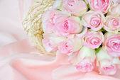Roses on satin fabric — Stock Photo