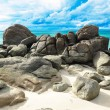 Beautiful beach with big rocks and blue sky — Stock Photo