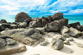 Beautiful beach with big rocks and blue sky — Stok fotoğraf