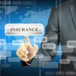 Businessman touching INSURANCE sign — Stock Photo