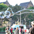 A man playing big bubbles  — Foto Stock