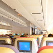 Aircraft cabin interior with passengers — Stock Photo