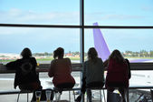 Passengers waiting for the flight at airport terminal — Stock Photo