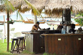 People at the bar near the seashore — Stockfoto