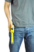 A man holding a tape measure — Stock Photo