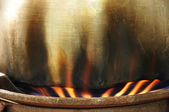 Fire under the cooking pot — Stock Photo