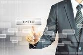 Businessman touching Enter sign — Zdjęcie stockowe
