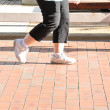 Legs of womwalking slowly on footpath — Stock Photo #36020553